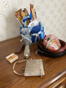 Pin cushions, lot of pencils, 2 belts, charms