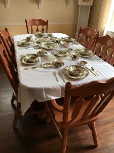 Dinning room table and 6 chairs excludes dishes on table