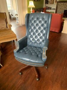 Blue Leather office chair on wheels