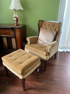Holstered wing back chair and footstool