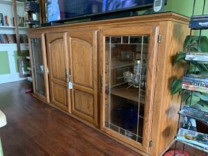 Oak TV cabinet with leaded glass and pull out shelves