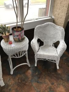 Wicker rocker and side table excluding contents on table