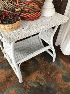 Wicker love seat and side table excluding contents on table
