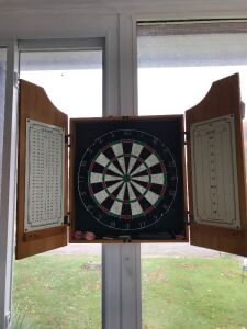 Dart board in cabinet