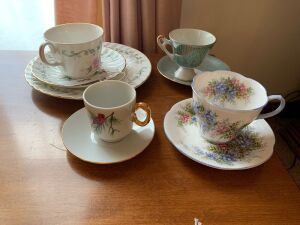 Four tea cups and saucers, one plate