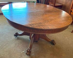 "Quartersawn oak pedestal 48"" table with heavy carved legs"