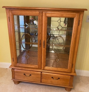 Cabinet with glass shelves and leaded glass doors
