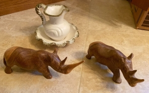 Wooden rhino figures, miniature pitcher and bowls