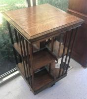 Antique tiger oak Mission style rotating stand / bookcase