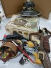 Vintage cowboy toys and leather items