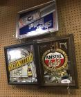 Three Mirrored beer signs