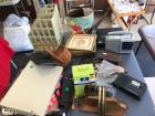 Portable radio, keyboard, bookends, gold framed pictures, watering can