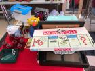 Monopoly game, gold picture frames, plastic boxes, 7 red glass votive cups, bank, muscle kind heat wrap, luggage carrier