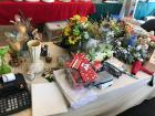 Lot of floral arrangements, adding machine, DVD's, candle holders