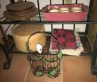 Bamboo steamer, placemats, wine basket and ceramic dishes