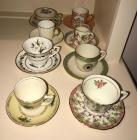 8 miniature cups and saucers