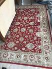 Red and tan decorative rug